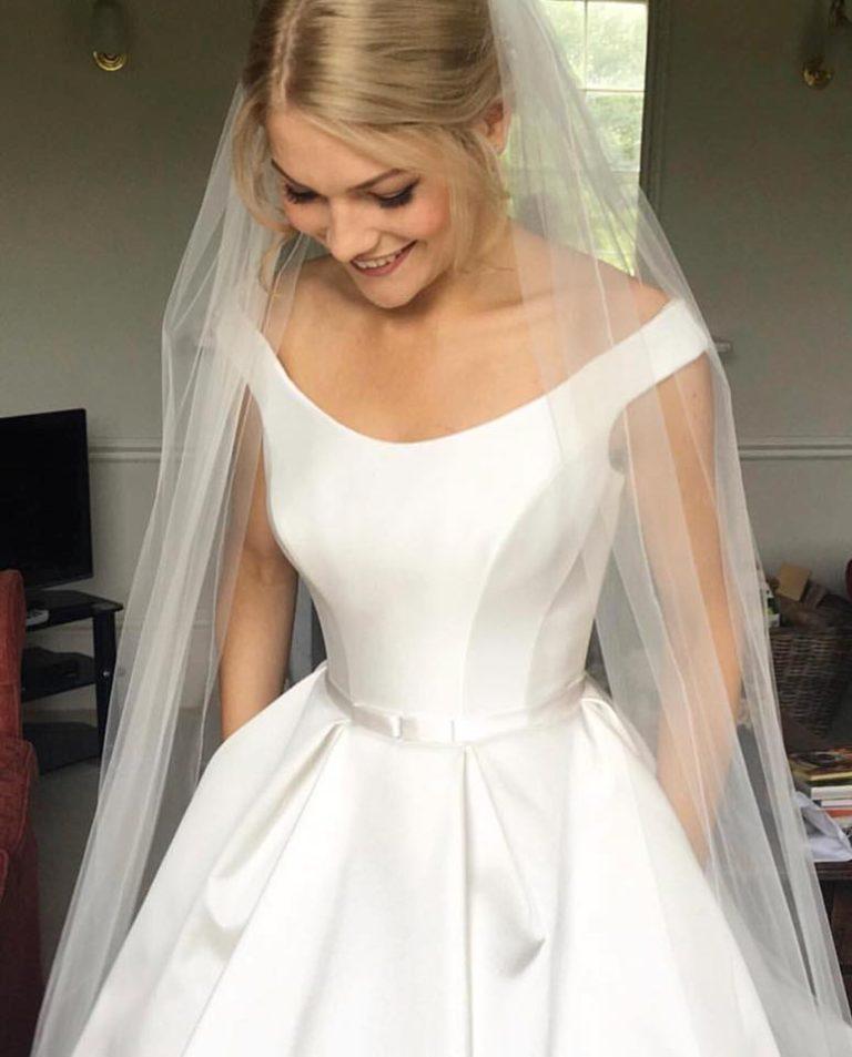 Sneak peek at Jessica in her exquisite Suzanne Neville Monet wedding dress!