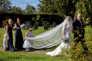 Lucy wearing an exquisite lace Stewart Parvin wedding dress with matching statement veil.