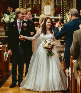 Beautiful bride Taya in her Suzanne Neville wedding dress 'Gracie' with a gorgeous lace shrug.