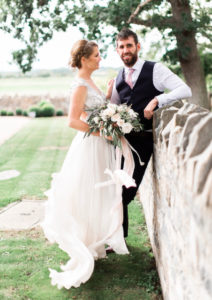 Stunning bride Jennifer wearing her Alice Temperley wedding dress for her beautiful barn wedding.