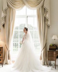 Bride looks effortlessly beautiful in her Caroline Castigliano gown at grand stately home wedding